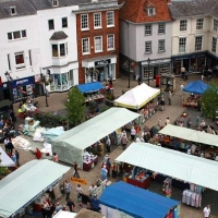 A view looking down on the stalls of the Monday market in the Market Place