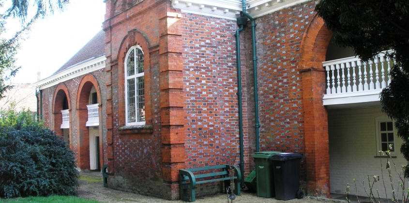 The churchyard frontage of the Brick Alley Almshouses in 2013.