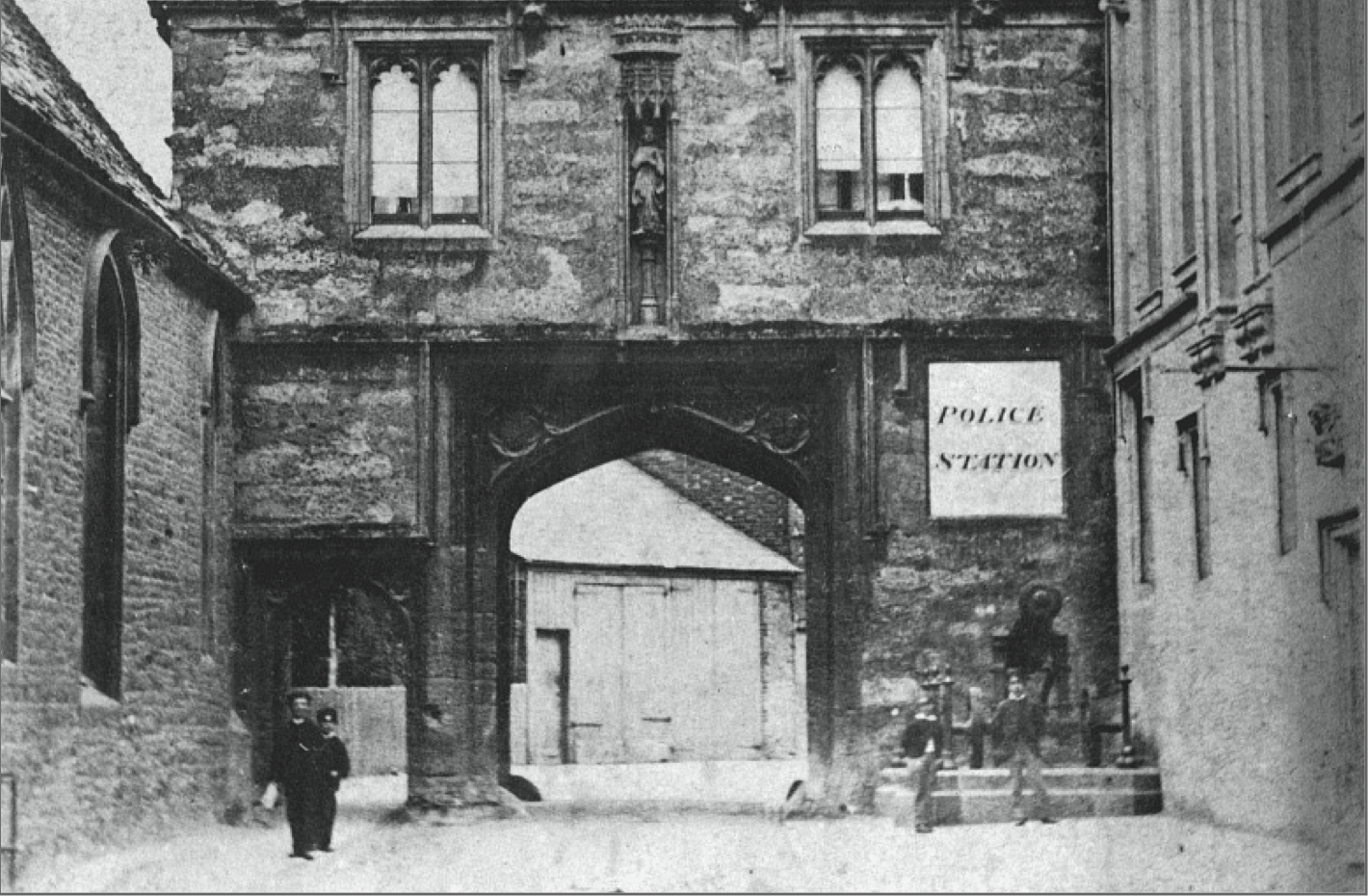 The Abbey Gateway in about 1860. The cannon is a relic of the Crimean War.