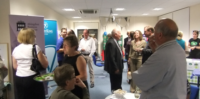Business people meeting each other and enjoying canapes at a business exhibition