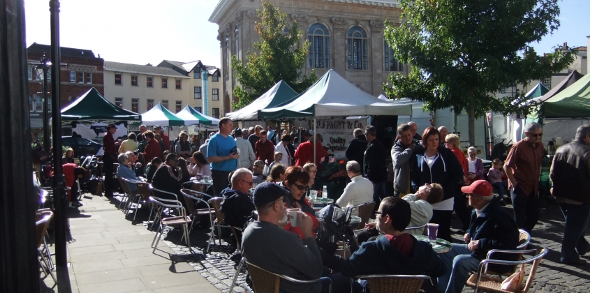 Sitting at café tables in the sunshine with market shopping is a pleasure