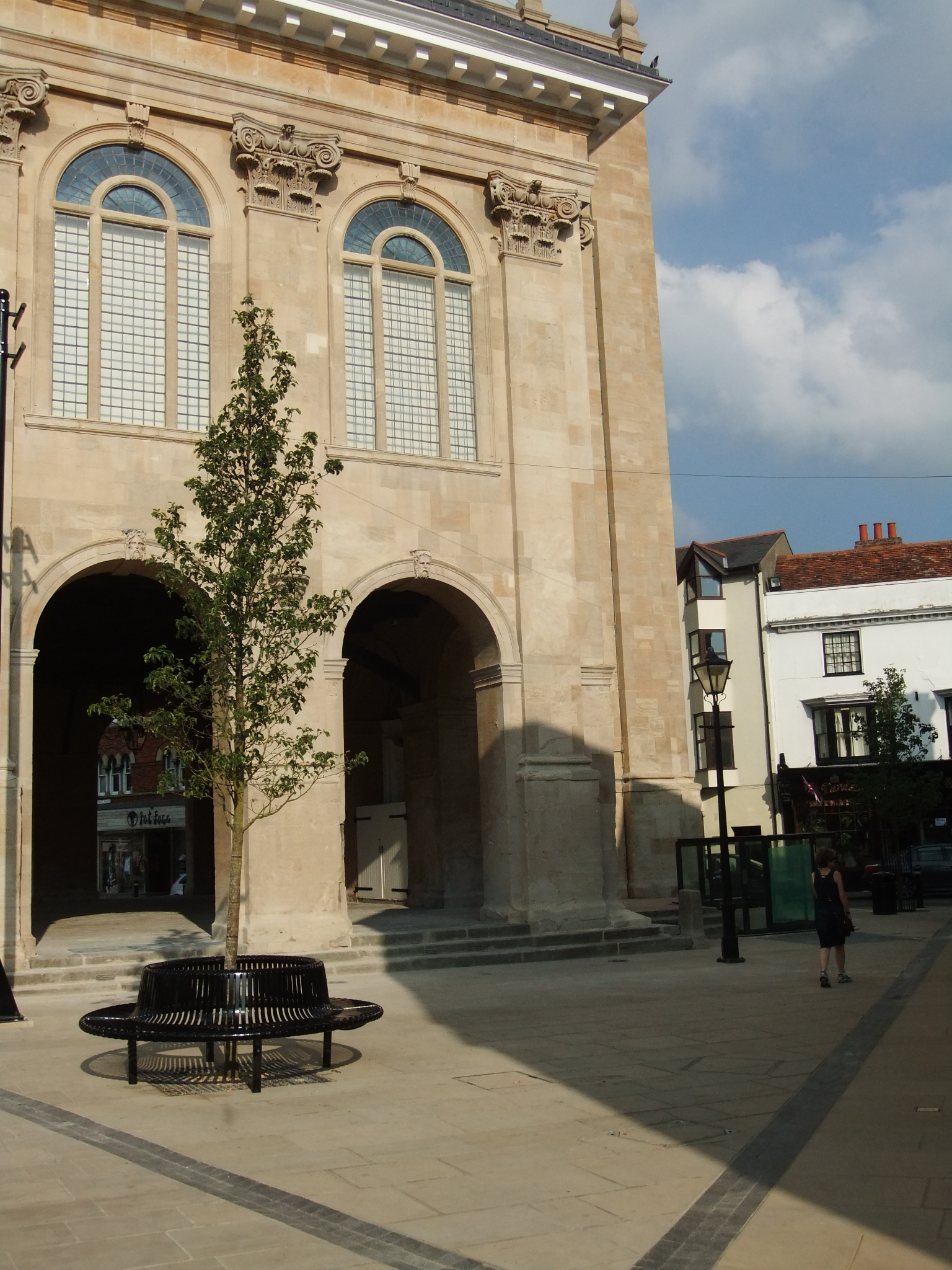 The side wall of the County Hall Museum viewed from the paved area with seating