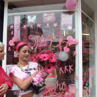 Pink themed shop window and shop assistant with pink flowers and pink clothes