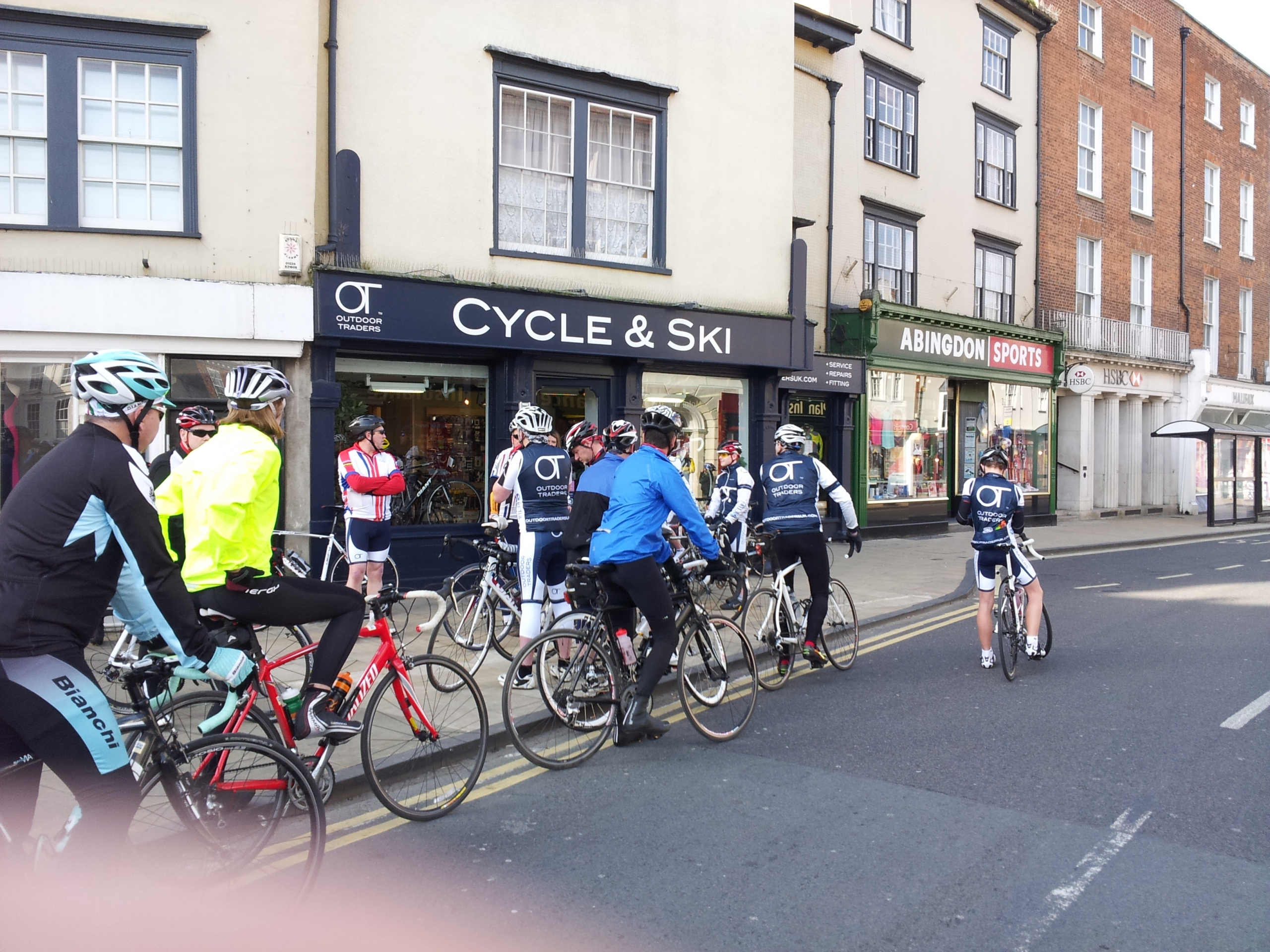 Cyclists on their bikes waiting to set off on a ride from Outdoor Traders shop on the High Street