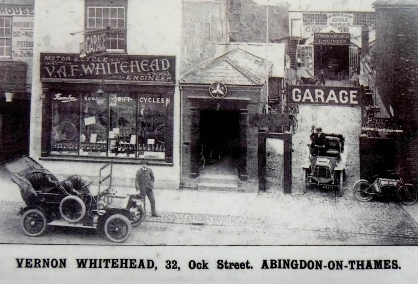 Coxeter's garage next to Vernon Whitehead's cycle shop at 32 Ock Street in about 1910.