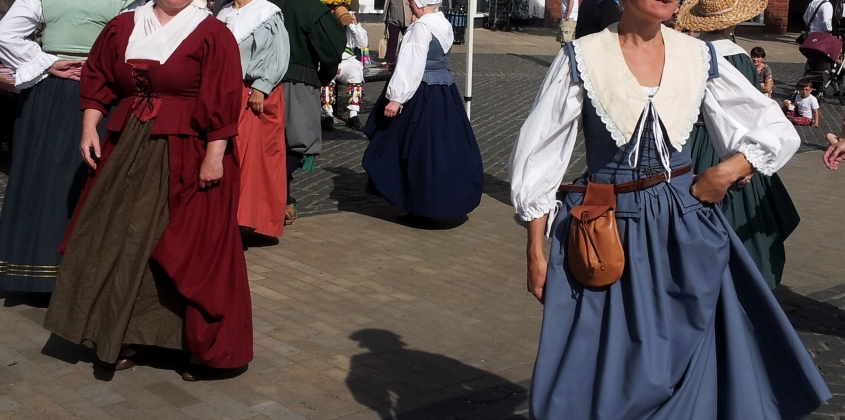 Sixteenth century costumed dancers in the Market Place