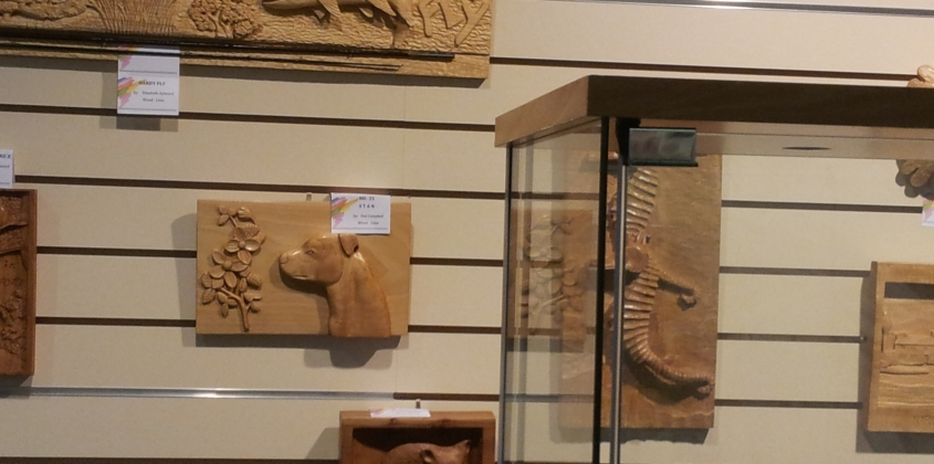Local woodcarvers work on display in town