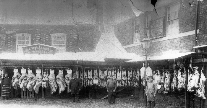 James Williams jnr (in bowler hat) outside his butchery about 1890. The Black Bull is on the right.