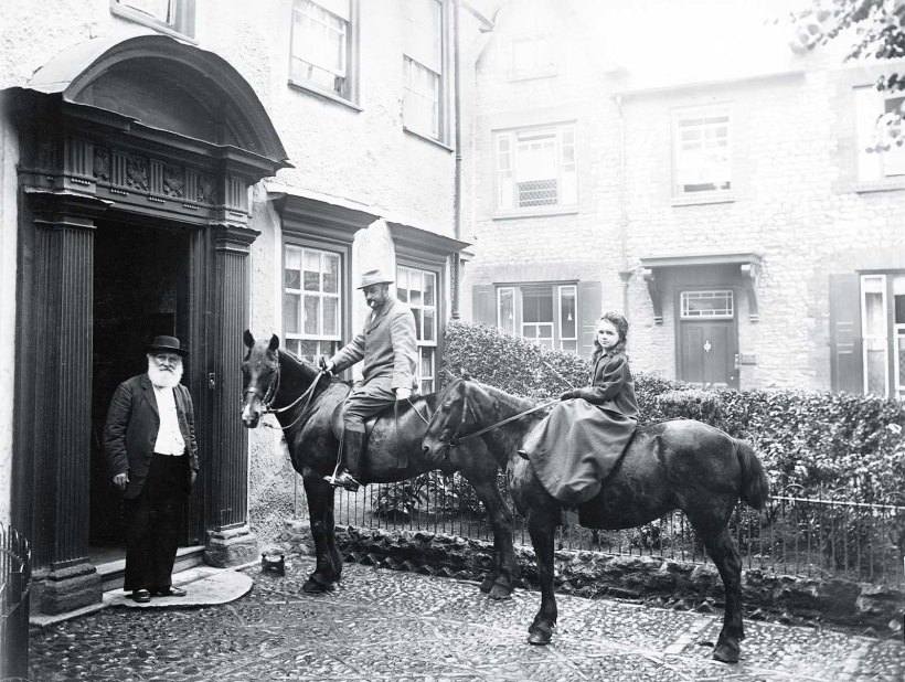 Timothy West and his daughter Mary on horseback, with his father, John, outside The Knowl in about 1905
