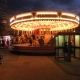 The fairground rides light up the Market Place