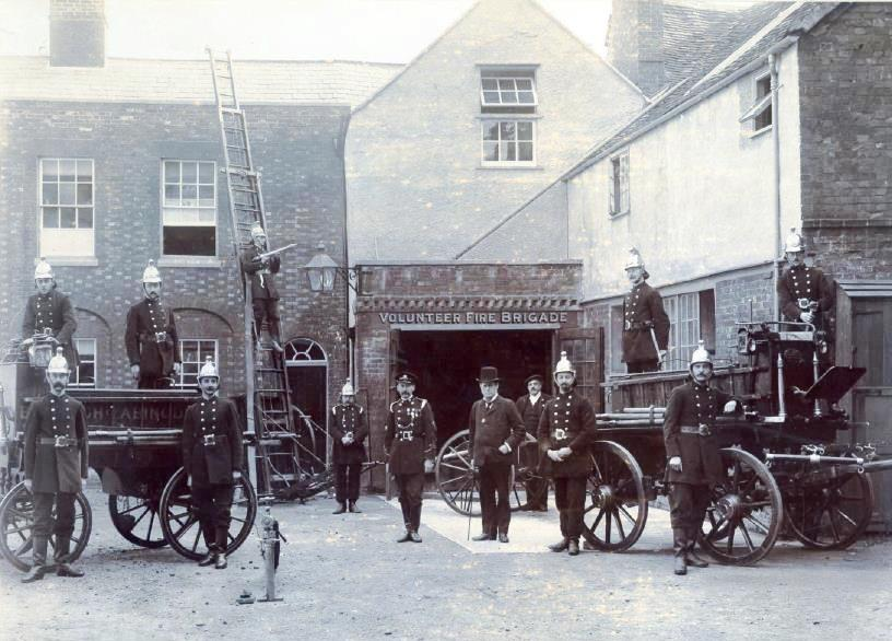 The fire engines and the Volunteer Fire Brigade in the Old Fire Station Yard in 1900