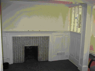 Enclosed fireplace in main reception room