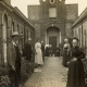 The residents in the courtyard of Tomkins' Almshouses in the early twentieth century