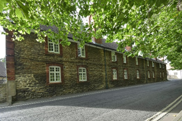 The rear façade of Brick Alley on St Helen's Wharf and facing the river